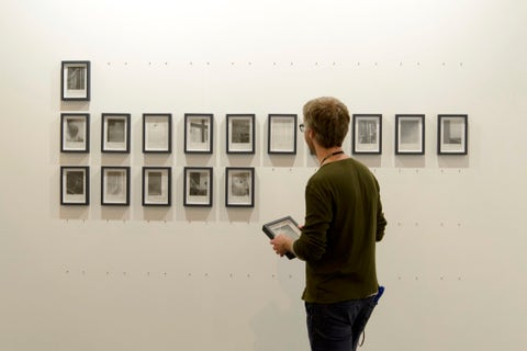 Sleeve, Shoulder, Standing, Wall, Elbow, Denim, Art gallery, Art exhibition, Grey, Picture frame,