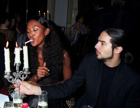 Mouth, Drinkware, Drink, Barware, Glass, Tableware, Wine glass, Black hair, Stemware, Suit,