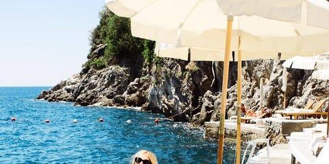 Vacation, Summer, Bikini, Sun tanning, Leisure, Swimwear, Sea, Outdoor furniture, Blond, Footwear,
