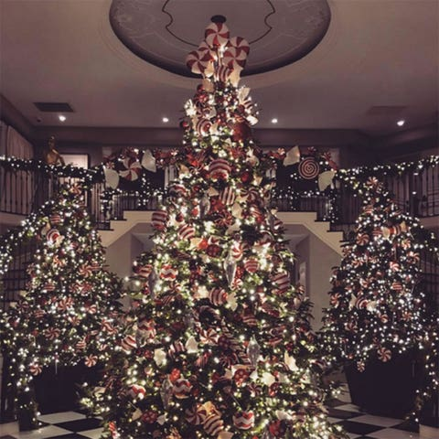 Lighting, Interior design, Event, Christmas decoration, Room, Property, Christmas tree, Red, Christmas ornament, Interior design,