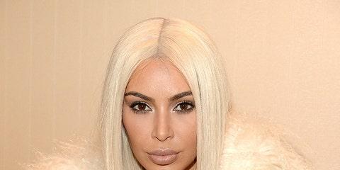 Lip, Hairstyle, Skin, Textile, Iris, Fashion, Fur clothing, Long hair, Blond, Fur,