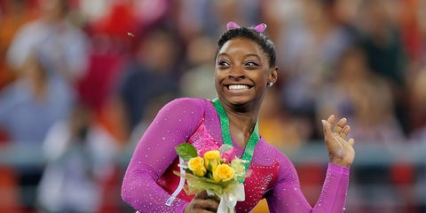 Happy, Facial expression, Thigh, Magenta, Lei, Individual sports, Gymnastics, Laugh, Celebrating, Rhythmic gymnastics,