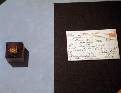 Brown, Handwriting, Paper product, Rectangle, Paper, Stationery, Document, Ring, Gemstone, Box,