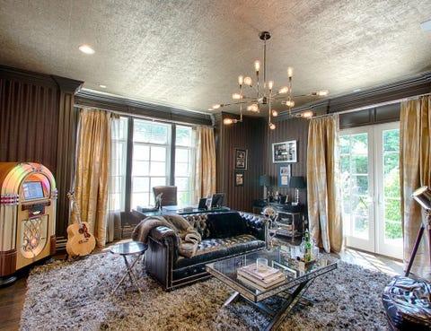 Room, Interior design, Ceiling, Floor, Interior design, Couch, Home, Light fixture, House, Living room,