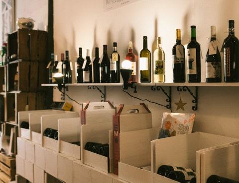 Glass bottle, Bottle, Alcohol, Drink, Alcoholic beverage, Wine bottle, Distilled beverage, Collection, Barware, Shelving,