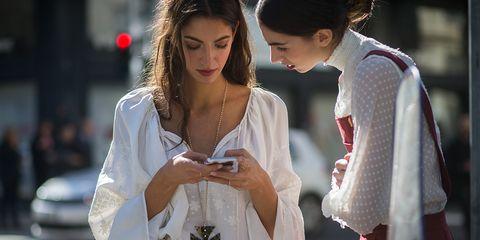 White, Street fashion, Fashion, Beauty, Lip, Skin, Interaction, Human, Outerwear, Shoulder,