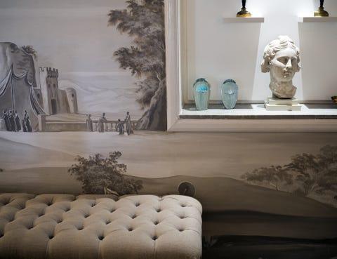 Wall, Interior design, Art, Couch, Sculpture, Interior design, studio couch, Design, Artifact, Living room,