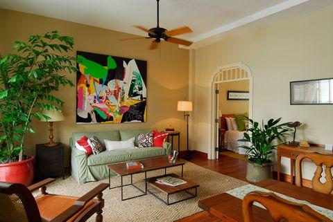 Wood, Room, Interior design, Lighting, Green, Floor, Flooring, Living room, Home, Table,
