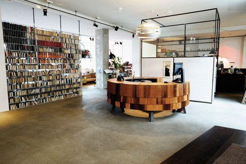 Lighting, Floor, Flooring, Interior design, Shelf, Shelving, Interior design, Light fixture, Houseplant, Retail,