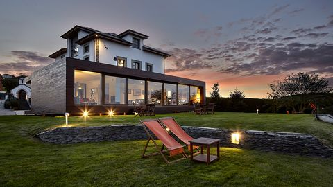 House, Home, Real estate, Residential area, Facade, Outdoor furniture, Dusk, Evening, Lawn, Sunset,