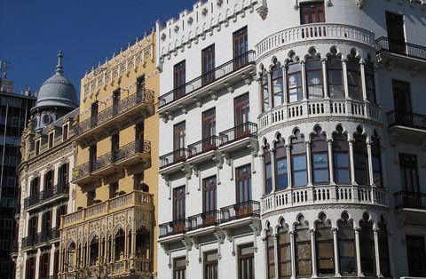 Architecture, Facade, Building, Landmark, Apartment, Mixed-use, Parallel, Material property, Urban design, Symmetry,