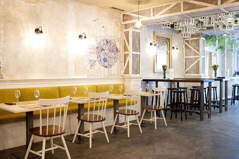 Lighting, Yellow, Room, Interior design, Floor, Furniture, Table, Ceiling, Flooring, Light fixture,
