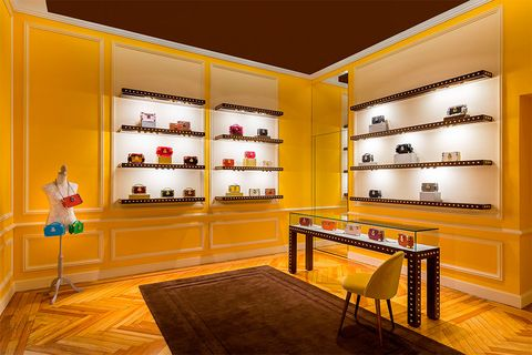 Interior design, Yellow, Room, Building, Furniture, Display case, Wall, Architecture, Design, Ceiling,