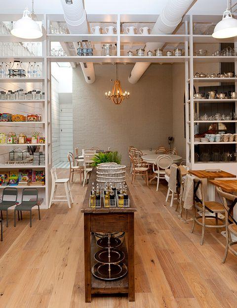 Wood, Lighting, Interior design, Floor, Room, Hardwood, Furniture, Light fixture, Shelf, Ceiling,