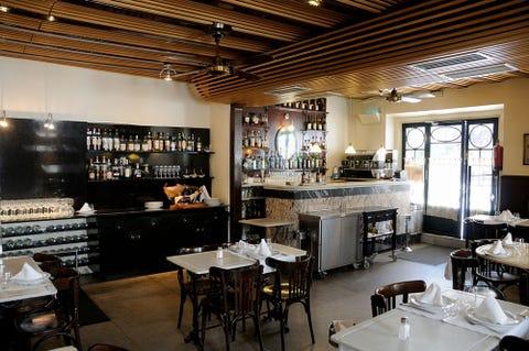 Lighting, Interior design, Room, Table, Furniture, Ceiling, Restaurant, Glass, Interior design, Light fixture,