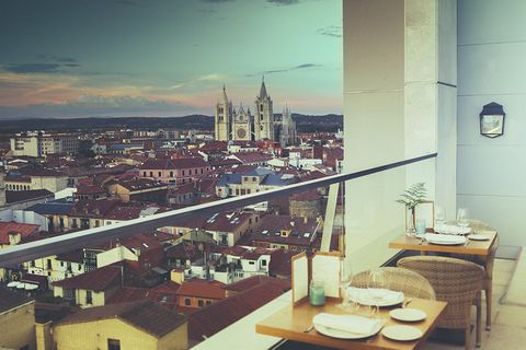 Table, Furniture, Roof, Urban area, Dishware, Tower, Kitchen & dining room table, Cityscape, Spire, Steeple,