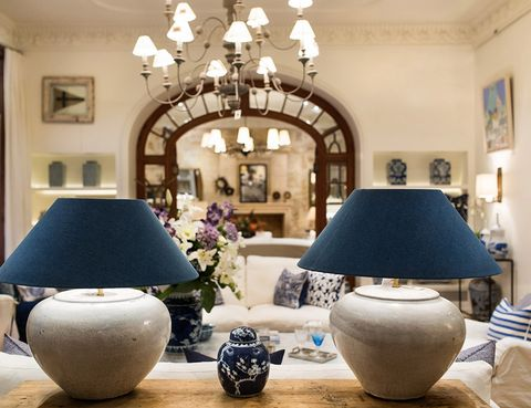 Interior design, Living room, Room, Lighting, Wall, Property, Furniture, Light fixture, Lighting accessory, Purple,