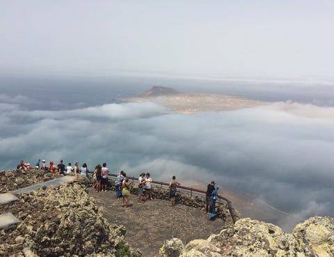Atmospheric phenomenon, People in nature, Geology, Shore, Coast, Adventure, Geological phenomenon, Walking, Mist, Haze,