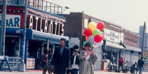Balloon, Town, Party supply, Street, Pedestrian, Street fashion, Commercial building, Downtown, Walking, Walkway,