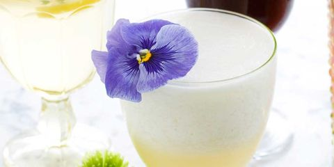 Yellow, Glass, Drinkware, Petal, Serveware, Flowering plant, Tableware, Stemware, Fruit, Champagne stemware,