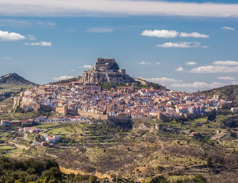 Sky, Landmark, Cloud, Town, Mountain, Human settlement, Hill, City, Landscape, Village,