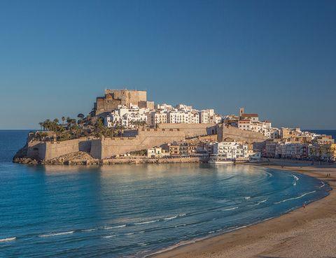 Body of water, Sea, Coast, Promontory, Sky, Town, Coastal and oceanic landforms, Azure, Tourism, Headland,