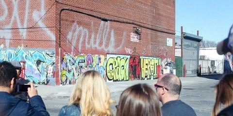 People, Wall, Crowd, Street art, Art, Urban area, Mural, Event, Street, Graffiti,