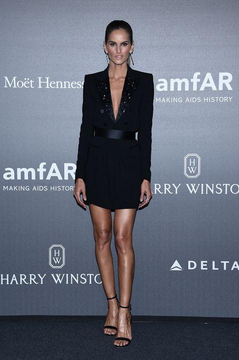 Clothing, Dress, Fashion, Suit, Fashion model, Cocktail dress, Little black dress, Formal wear, Shoulder, Footwear,