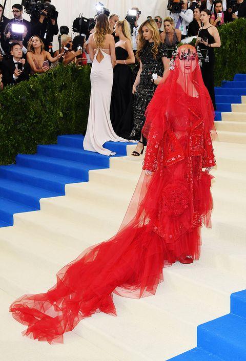 Red carpet, Dress, Gown, Carpet, Clothing, Fashion, Flooring, Strapless dress, Haute couture, Shoulder,