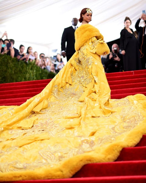 Human, Yellow, Dress, Gown, Costume design, Fur, Dish, Tradition, Haute couture, Costume,