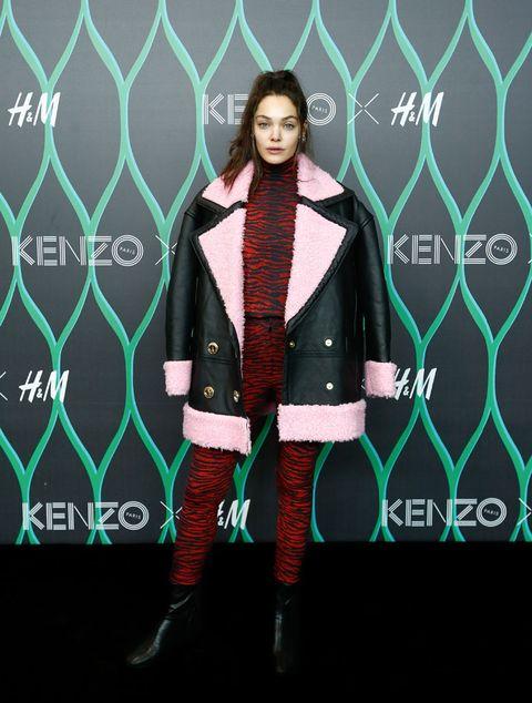 Collar, Pattern, Boot, Fashion model, Costume design, Costume accessory, Fur, Costume, Fashion design, Knee-high boot,