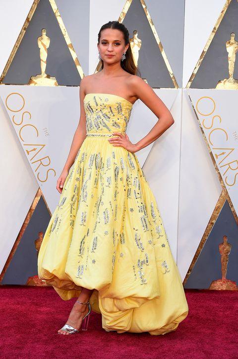 Clothing, Yellow, Dress, Shoulder, Textile, Flooring, One-piece garment, Formal wear, Style, Carpet,