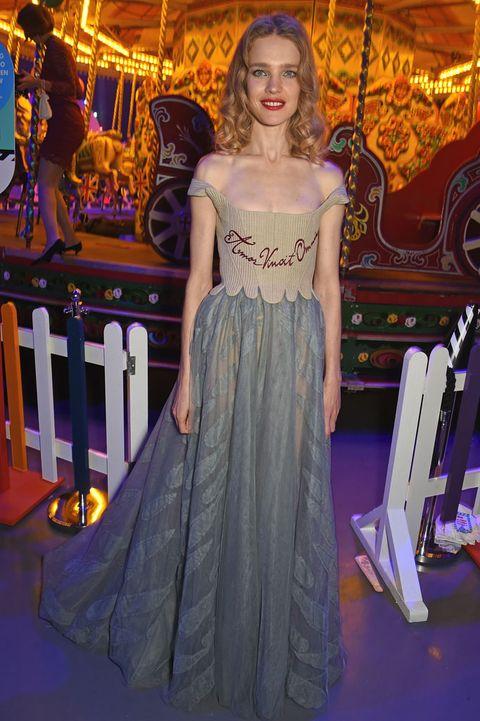 Textile, Dress, Purple, Formal wear, Gown, Waist, Long hair, One-piece garment, Carousel, Haute couture,
