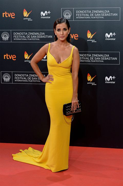 Yellow, Dress, Shoulder, Flooring, Style, Orange, Formal wear, Amber, One-piece garment, Waist,