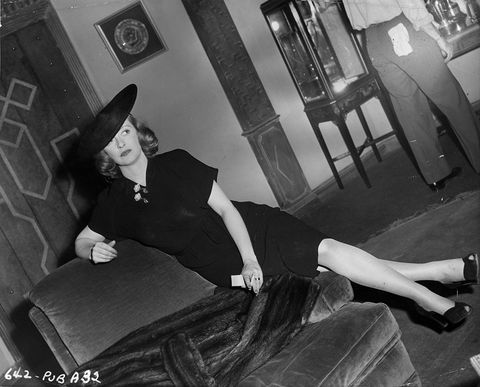 Hat, Comfort, Black, Black hair, Knee, Picture frame, Sun hat, Flash photography, Lamp, Fedora,