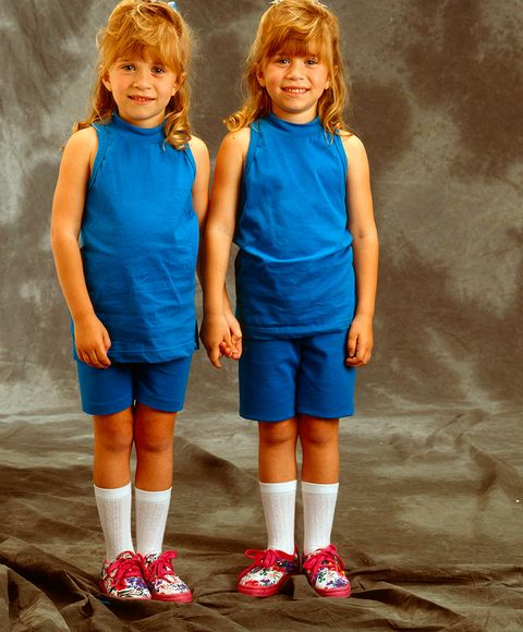 Sleeve, Human leg, Style, Shorts, T-shirt, Knee, Electric blue, Azure, Sock, Uniform,