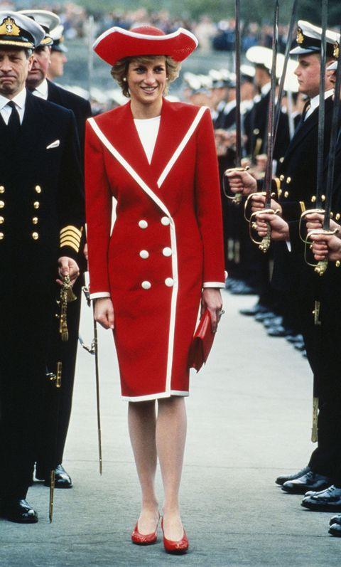 Clothing, Uniform, Fashion, Outerwear, Coat, Headgear, Street fashion, Formal wear, Suit, Military uniform,