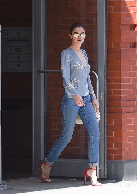Jeans, Clothing, Denim, Blue, Fashion, Street fashion, Footwear, Waist, Shoulder, Standing,