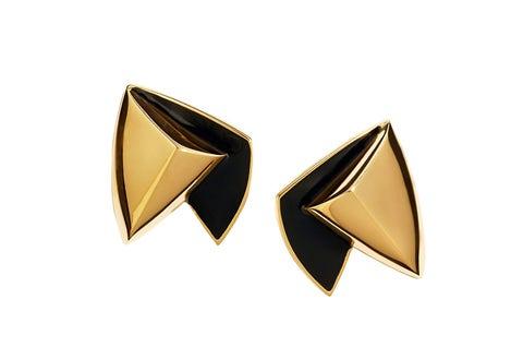 Yellow, Amber, Font, Symbol, Triangle, Metal, Bronze, Material property, Graphics, Bronze,