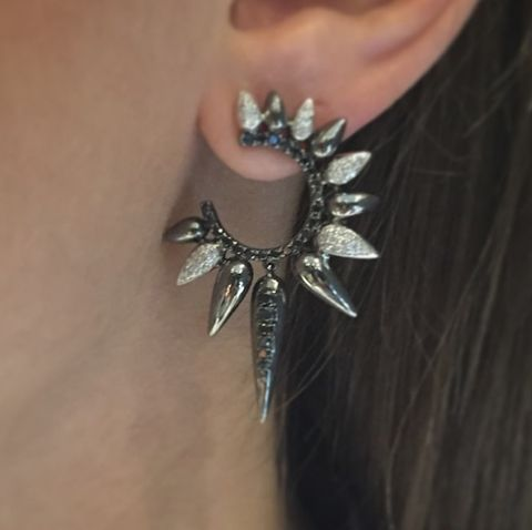 Skin, Jewellery, Fashion accessory, Body jewelry, Metal, Photography, Wing, Silver, Natural material, Fashion design,
