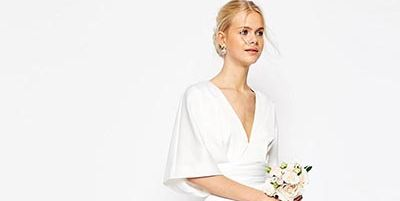 Sleeve, Shoulder, Textile, Dress, Standing, Joint, White, Elbow, Bridal clothing, Wedding dress,