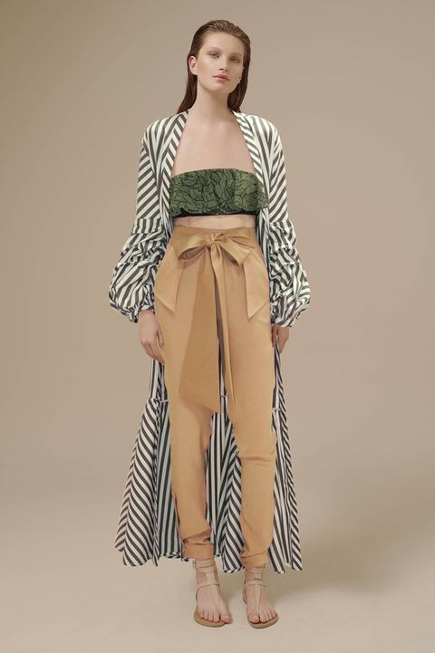 Leg, Brown, Sleeve, Shoulder, Human leg, Textile, Joint, Style, Fashion show, Fashion model,
