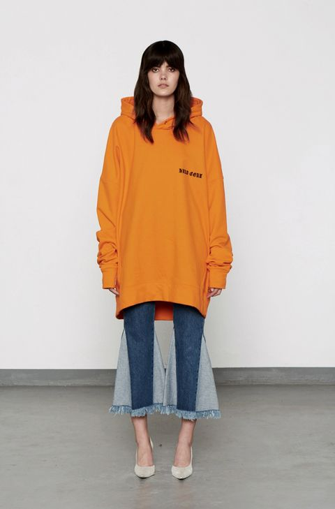 Clothing, Sleeve, Shoulder, Textile, Joint, Outerwear, Standing, Style, Orange, Street fashion,