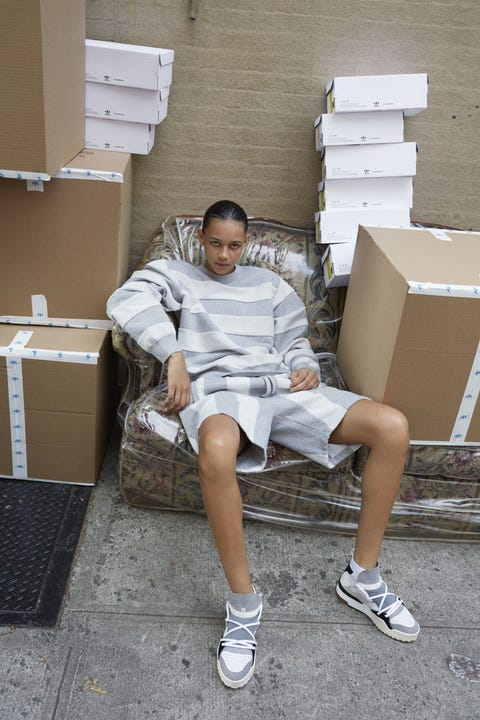 Footwear, Leg, Shoe, Human leg, Shorts, Athletic shoe, Sneakers, Shipping box, Knee, Box,