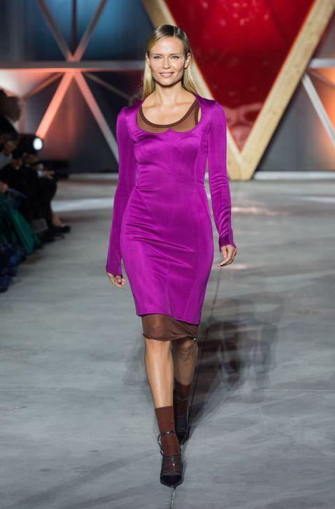 Fashion show, Fashion model, Fashion, Runway, Clothing, Shoulder, Cocktail dress, Fashion design, Purple, Dress,