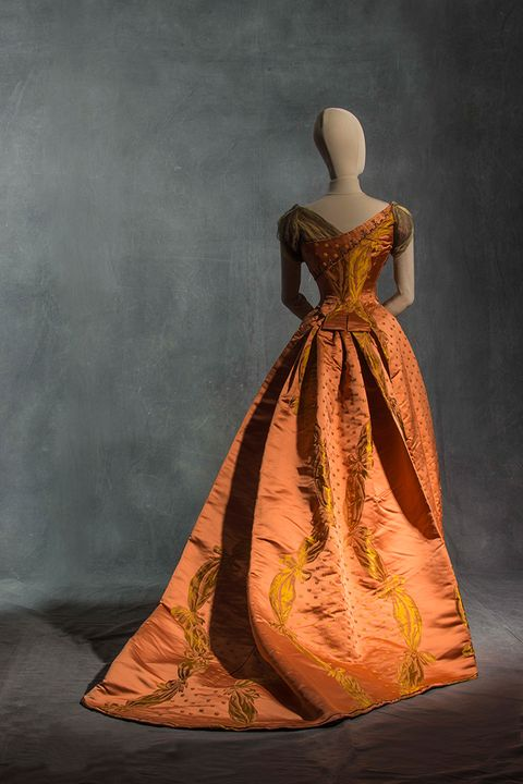 Dress, Formal wear, Amber, One-piece garment, Gown, Costume design, Fashion, Art, Toy, Day dress,