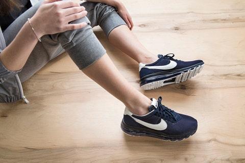 Footwear, Shoe, Human leg, Athletic shoe, White, Floor, Light, Running shoe, Fashion, Denim,