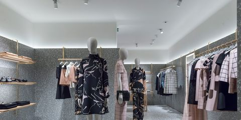 Boutique, Clothing, Room, Fashion, Interior design, Black-and-white, Building, Outerwear, Dress, Fashion design,