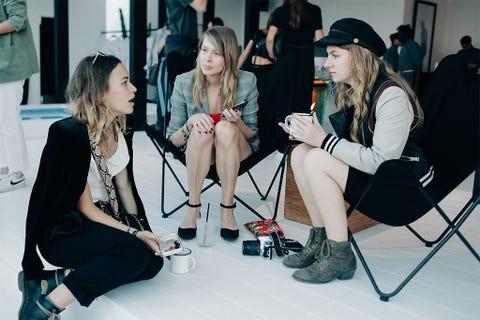 Footwear, Leg, Arm, Trousers, Human body, Hat, Outerwear, Sitting, Style, Fashion accessory,