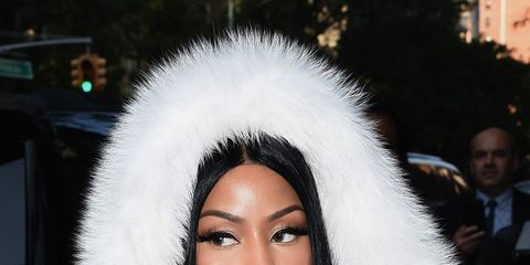 Fur clothing, Fur, Fashion, Beauty, Black hair, Headgear, Street fashion, Textile, Fashion accessory, Cap,
